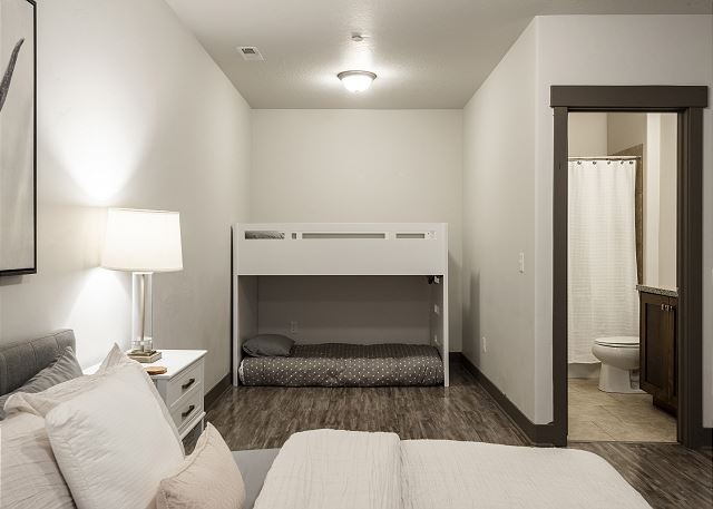 Lower Level Master Bedroom with King Bed and Twin-over-Twin Bunk Bed and En Suite Bathroom