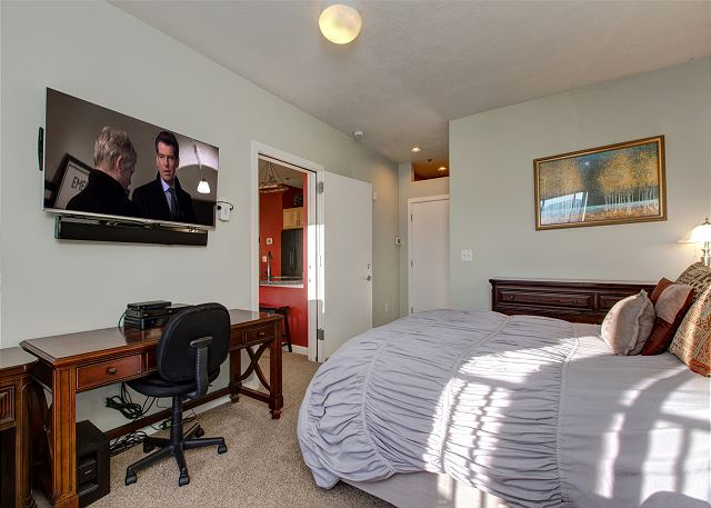 Master Bedroom with Comfy Queen Bed, TV, Desk and En Suite Bathroom