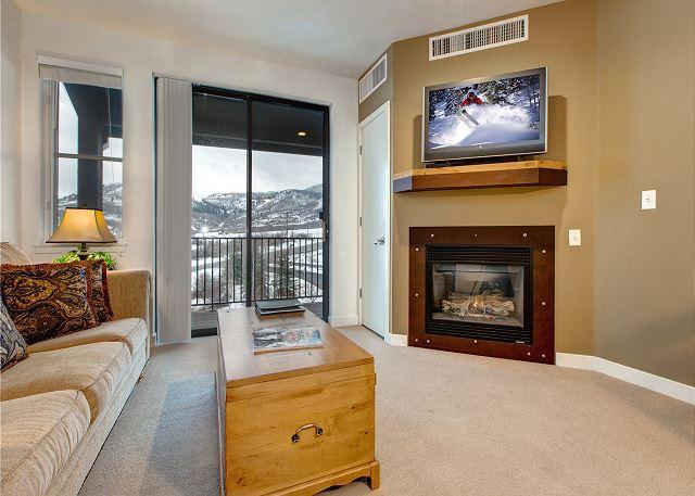Main Living Area with Sleeper Sofa, TV, Gas Fireplace and Balcony