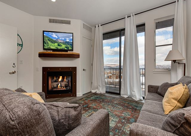 Main Living Room with Sleeper Sofa, Gas Fire Place, TV and Balcony with Views! - Top Floor!
