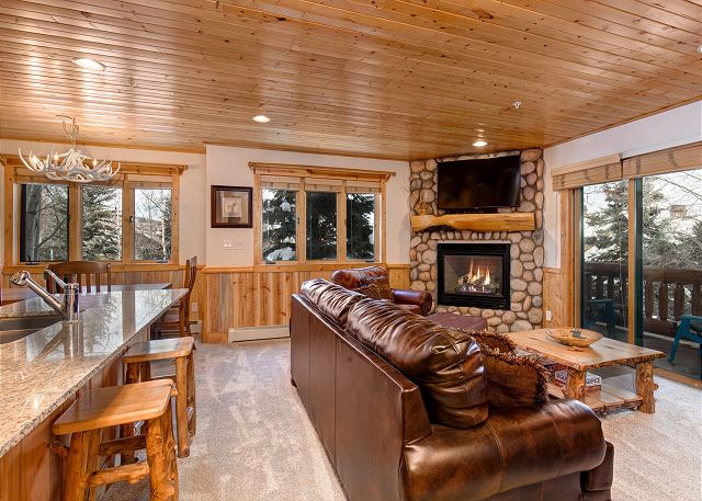 Open Living, Kitchen, Dining Area with Large Smart TV, Gas Fireplace and Deck with BBQ