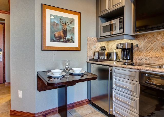 Kitchenette with Fold Down Table, Full Dishwasher, Cook Top, Small Fridge, Microwave and Coffee Pot