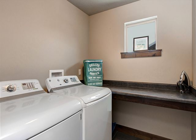 Laundry Room with High Efficiency Washer and Dryer