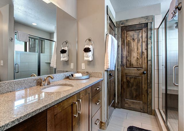 Large En Suite Master Bathroom with Two Vanity Areas and Walk-In