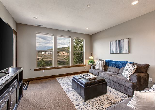 "Lower Level Family Room with 70"" TV! Sleeper Sofa and Game"