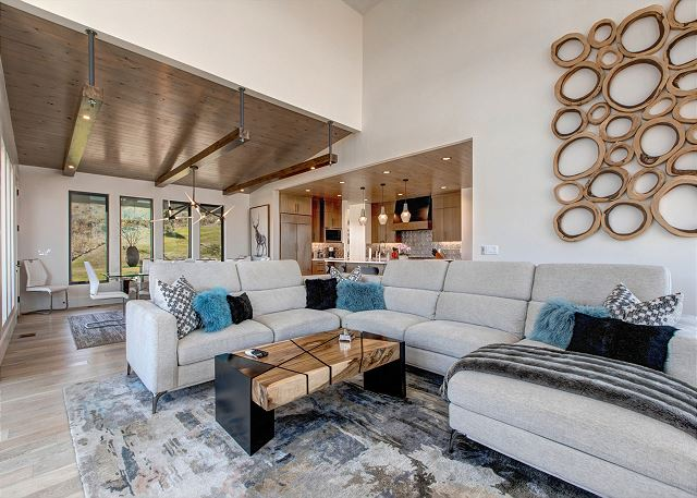 "Living Room: Gorgeous and comfortable with a large sectional sofa with adjustable headrests, and floor-to-ceiling stonework with a cozy gas fireplace and a 75"" Smart TV. The AV system is complete with a Sonos Surround system that also provides sound and m"