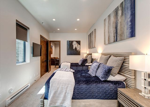 "On the first/garage level you will find the fourth master bedroom, featuring two queen-size beds, a 50"" Smart TV and Sonos, and a private bathroom with dual sinks and a tile walk in shower"