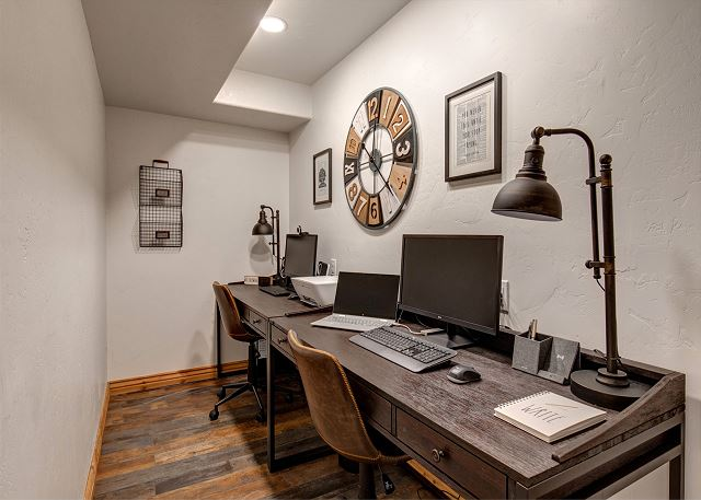 Home office with two desks! One desk has a full computer set up with a web cam and Microsoft Office and the second desk has a monitor, keyboard, mouse and a hub to easily connect your own laptop (laptop pictures is NOT included)