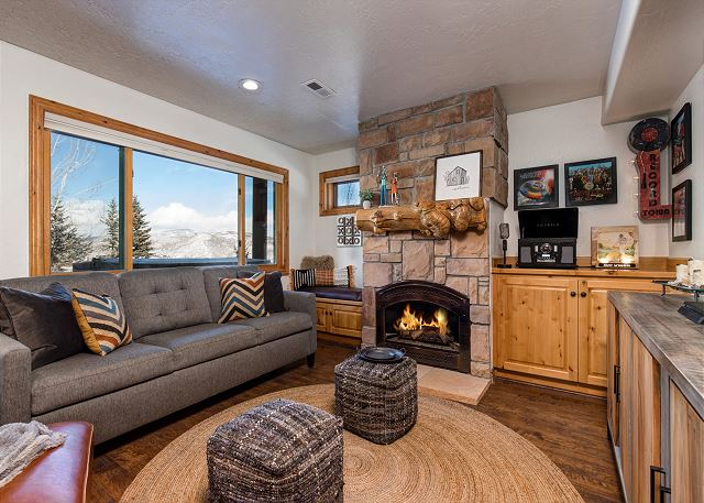 """Awesome living room space with KING sleeper sofa, comfortable seating, gas fireplace, music corner, 65"""" 4K Ultra HD TV with PS4 and more!"""