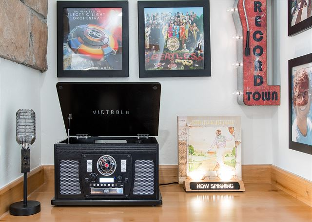 Music Corner: Complete with a vintage-style Victrola record player which can also play CDs or hook up to a phone or iPad with an AV cable (included) or Bluetooth for your music enjoyment. A choice of record albums is provided. Each wall frame opens to cha
