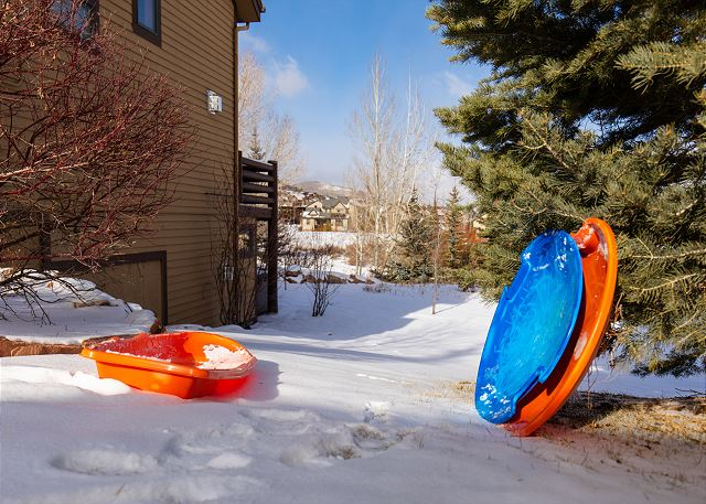 Sledding hill on the side of this home.