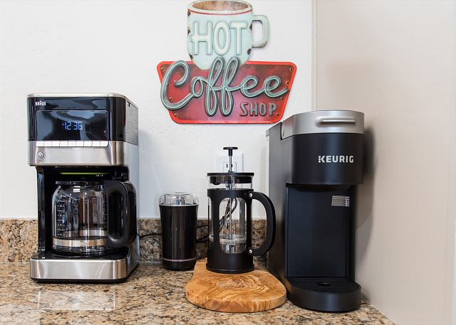 There is a coffee corner with a Braun coffee pot, a Keurig, a French press and a grinder to satisfy all coffee drinker's preferences and sufficiently caffeinate for the day!