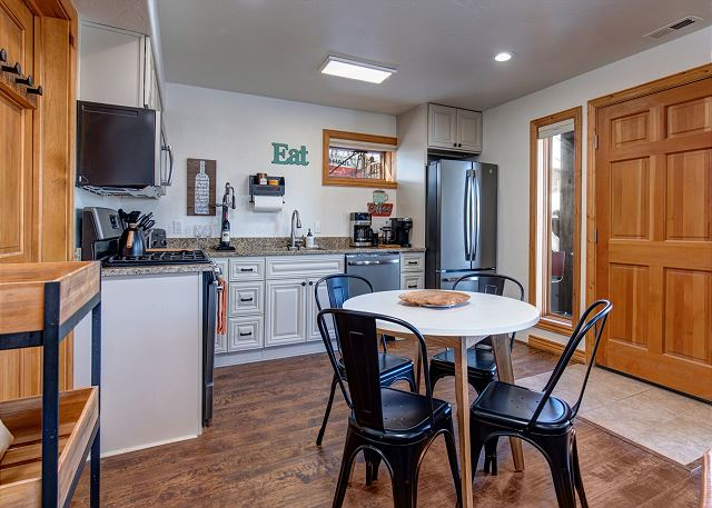 Full kitchen and fully equipped with everything you'll need for meals and snacks! Dishware, bakeware, glassware, crockpot, personal blender, waffle iron, toaster, coffee corner with Keurig and so much more!