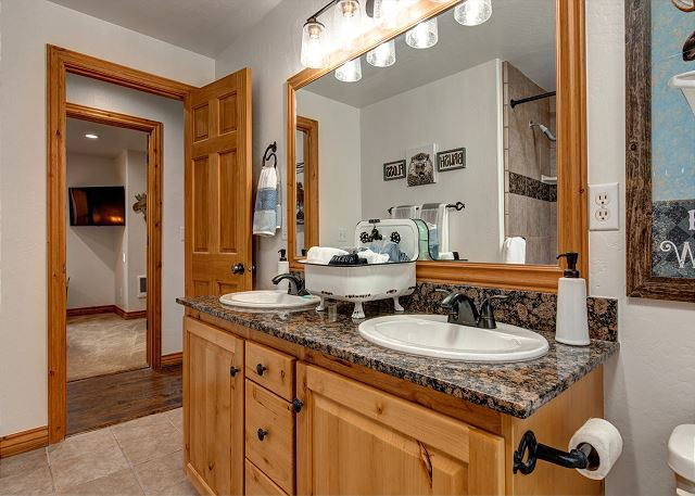 Full bathroom with dual sink vanity and 6' long, deep soaking tub and shower with rain head. The home as a tankless water heater for endless hot water!