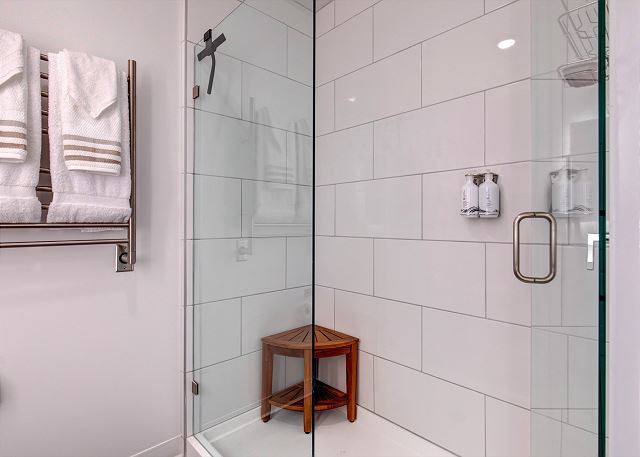Bathroom with heated towel bar, teak shower seat, shower head with handheld and organizer. What you see is what you get! Dont get run through a room rotation. Unit 406 has added amenities and set up for the best in comfort and convenience.