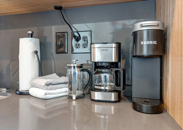 Unit 406 has updated amenities and includes a Keurig, coffee maker and French press.
