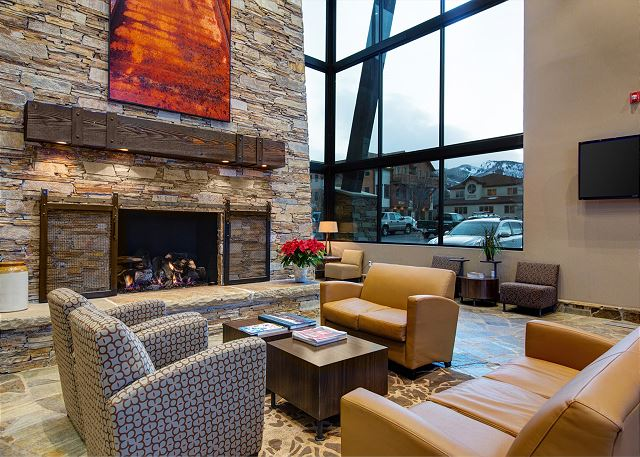 Lobby with fireplace, seating and 24-hour front desk assistance