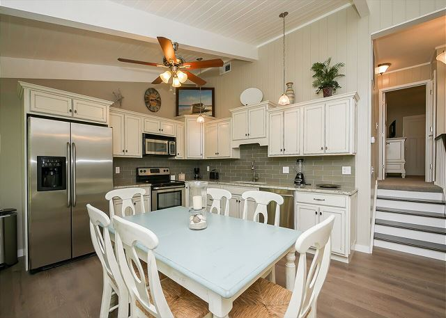 The newly renovated Kitchen / Dining Area features all stainless appliances, granite counters and dining table for six, and wood flooring throughout.