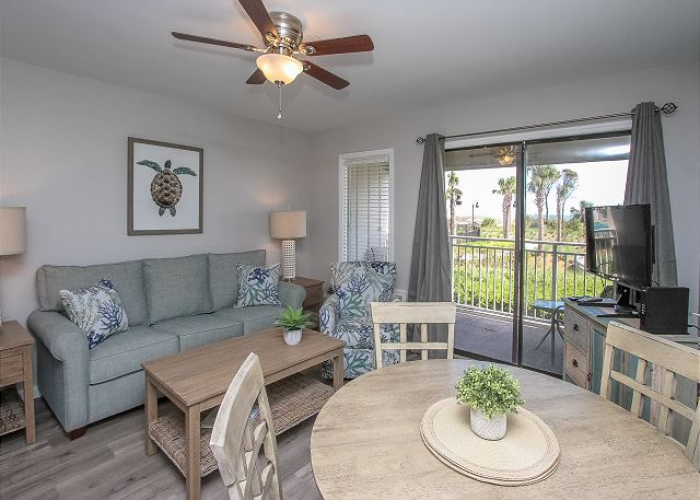 The Living Room Area has sliding door access to the Pool/Ocean view Balcony. Upscale furnishings and a flat screen .