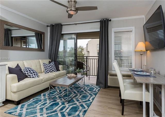 Beautifully decorated living and dining area with an inviting balcony to relax on.