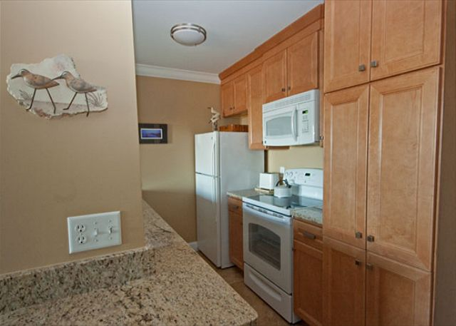 Completely upgraded kitchen w/new cabinets, granite counter top and tile flooring...