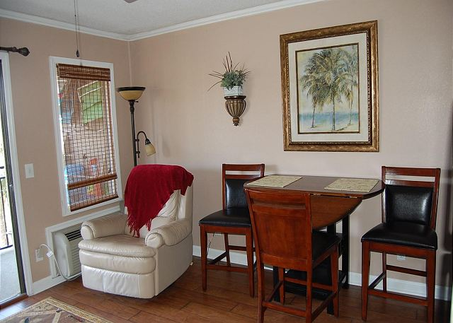 Beautifully decorated living and dining area with wood laminate flooring.