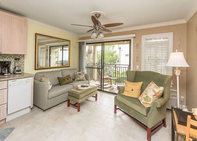 With comfortable furnishings in this condo the Living Room features tile floors and access to the oceanview balcony.