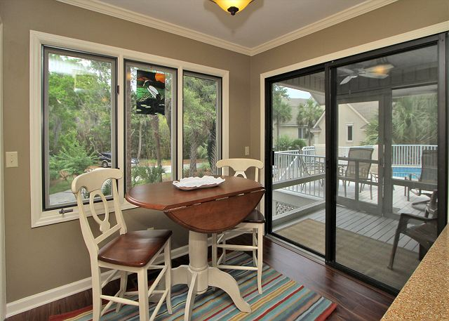 Breakfast Area that leads out to Screened Porch/Pool