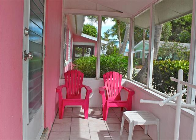 Each of the gulf view and gulf front cottages has a private screened in porch with matching adirondack chairs