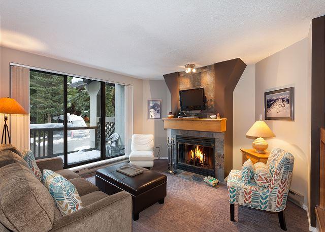 Lovely Sunken Living Room with wood burning fireplace