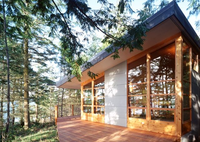 Welcome to Aria da Capo!  This beautiful, newly constructed, modern home looks through the trees at the waters of the Salish Sea.
