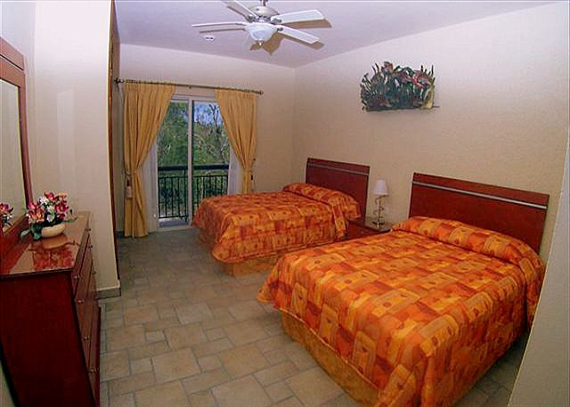 Bedroom 4 has a jungle view, and shares a bathroom with bedroom 2. There are 2 full size beds to sleep 4 persons.
