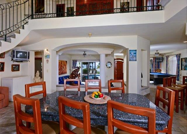 Enjoy your dinners on a gorgeous imported granite top dining table which can seat up to 10 people. The grand stairway leads from the spacious dining room to four large bedrooms on the second level. Fifth bedroom is on the ground floor.