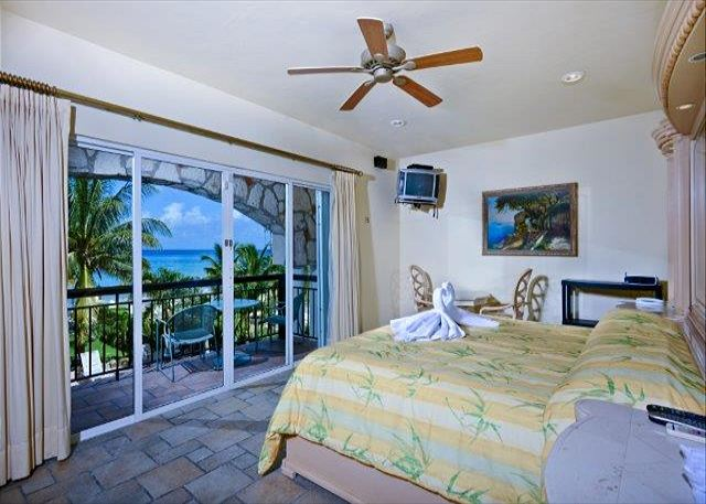 The master bedroom features an orthopedic king sized bed, Luis XV furniture, a private balcony, TV and private bathroom. Enjoy the beautiful ocean, sunset and swimming pool views from the private balcony.