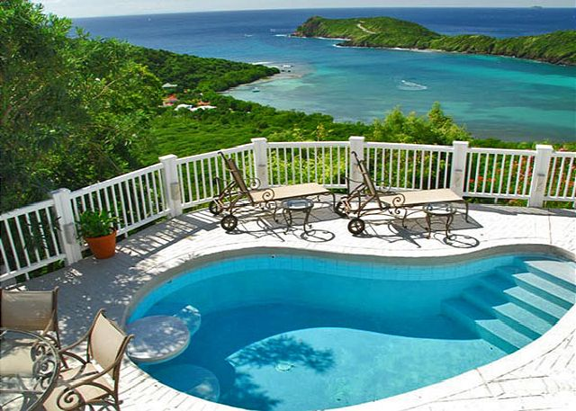 This is what a vacation is all about. A refreshing pool, restful lounging areas, lush vegeatation and ample privacy. And just look at the ocean view!