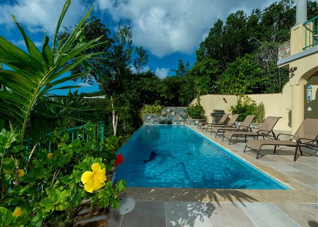 Exotic View Villa is a two-bedroom villa located on St. John's south shore surrounded by emerald green gardens filled with tropical flowers, fruits and fauna.